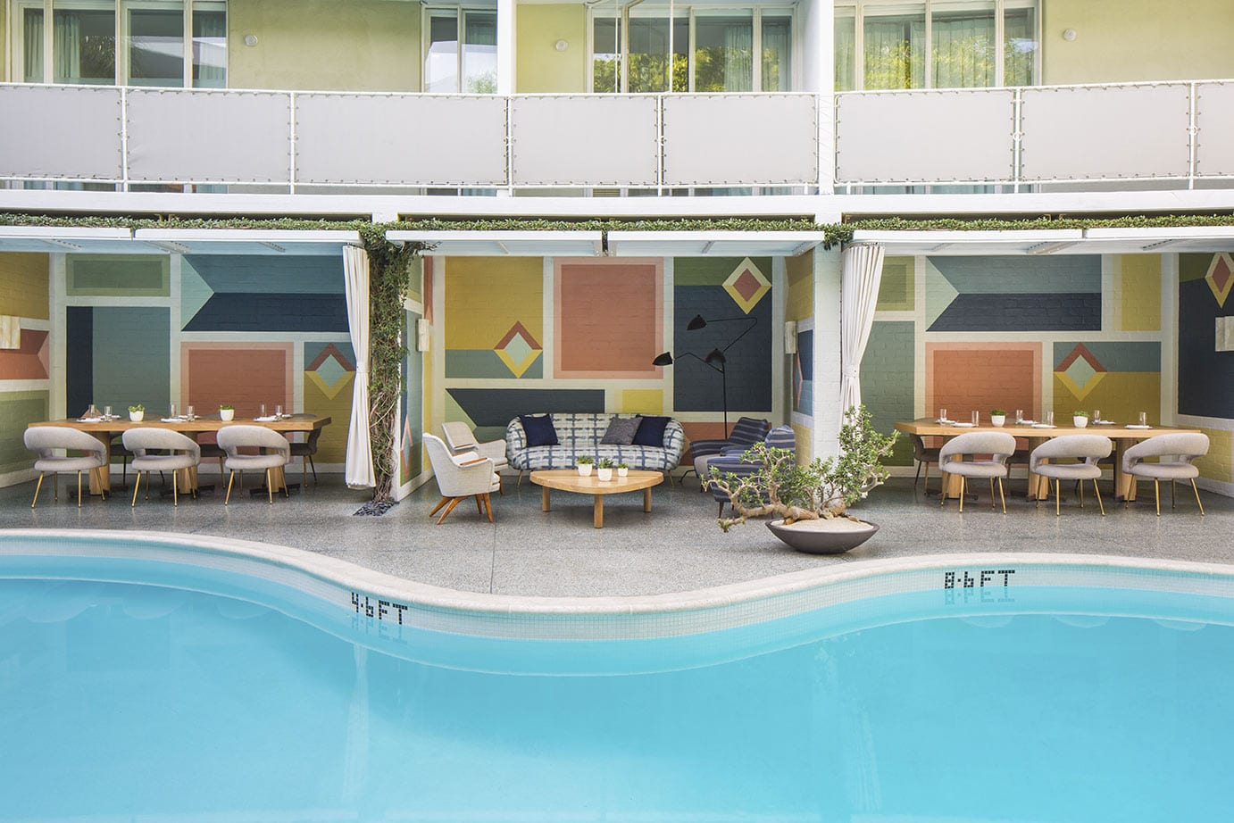 outdoor pool and dining area at Avalon Hotel Beverly Hills