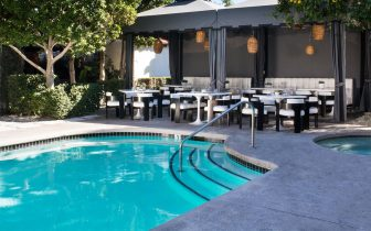 outdoor pool and dining area at Chi Chi Restaurant Palm Springs