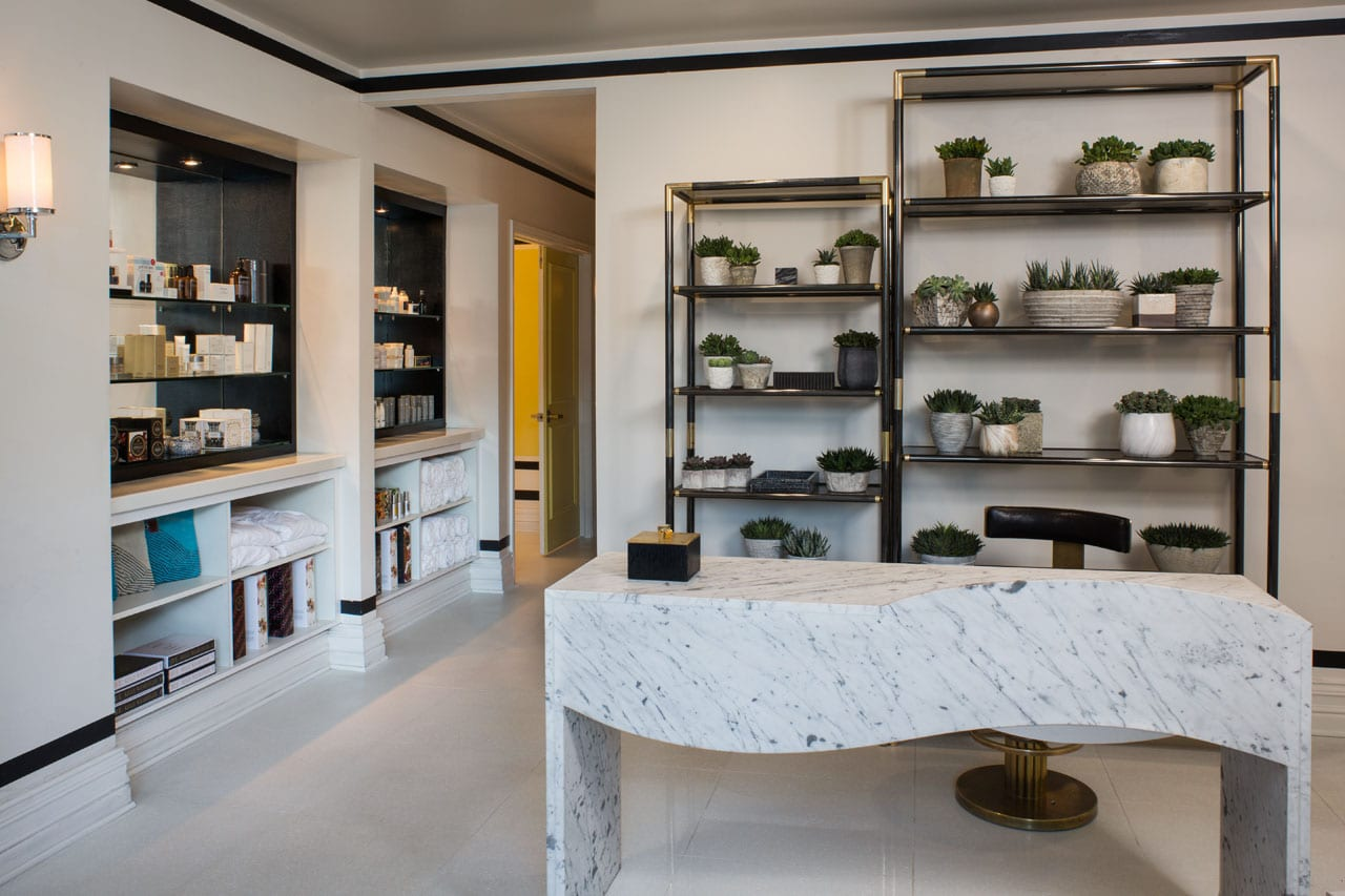 spa with table and shelves with plants and spa products