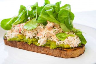 Closeup of toast with tuna and greens