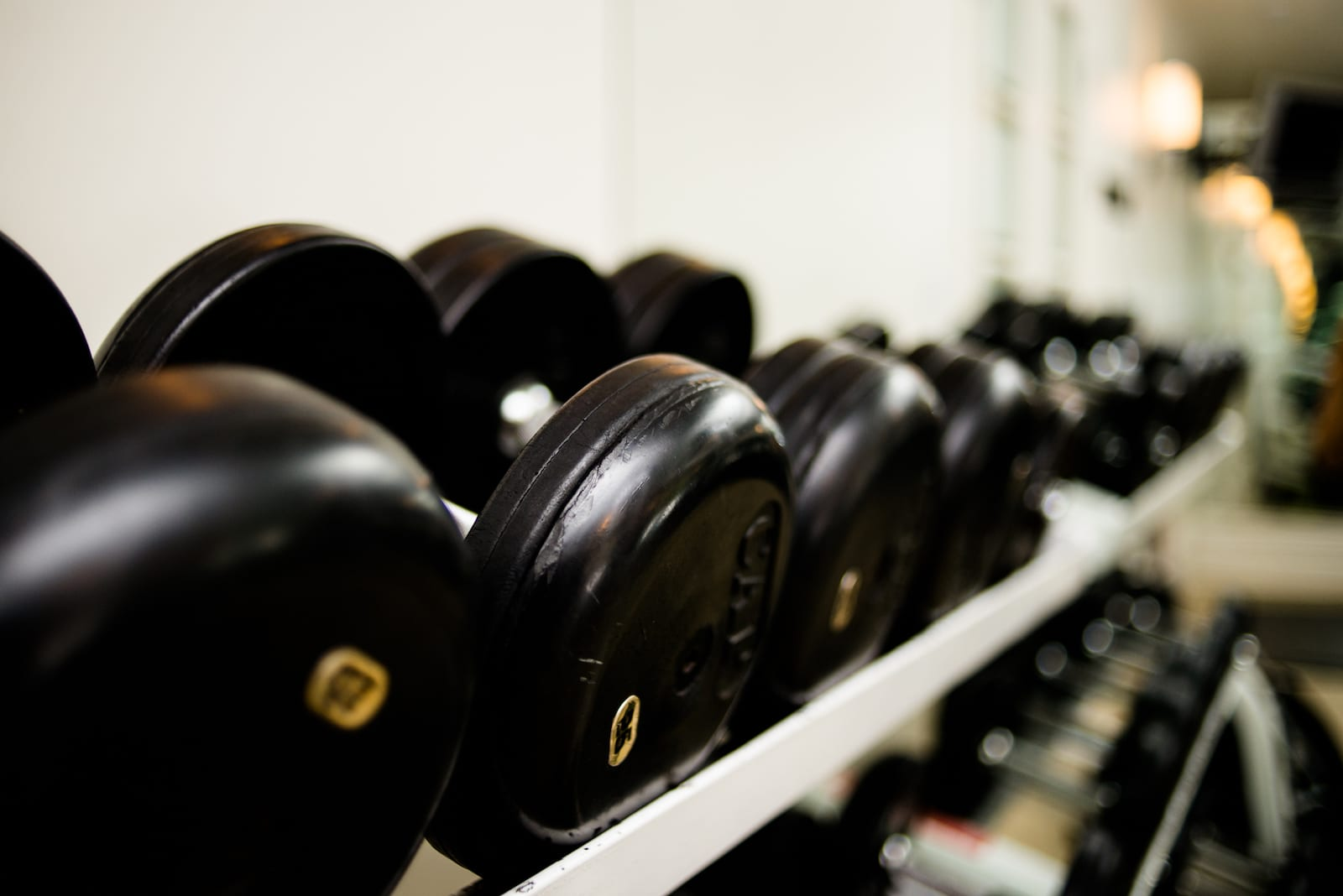 Closeup of dumbbells on rack