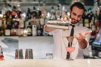 Viviane Bartender preparing a cocktail behind bar