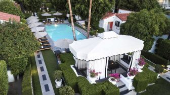 Overhead view of gazebo and pool area, surrounded by umbrellas and trees