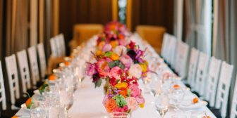 Large rectangular table with flower centerpieces