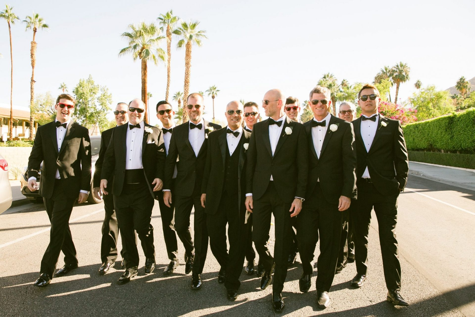 Groomsmen posing for photo outdoors
