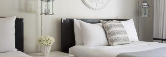 hotel beds with bed pillows and decorative pillows