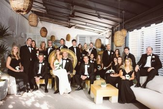 group photo of wedding party posing for portrait